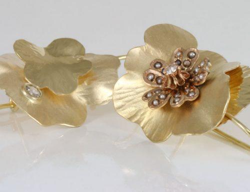Gouden oorhangers in geel en rosé goud met parels en diamanten