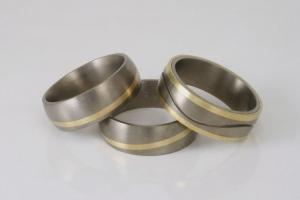 Titanium ringen ingelegd met goud